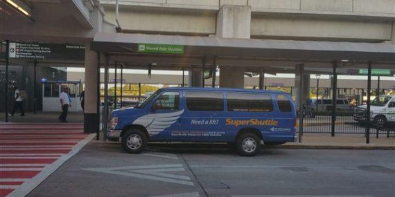 Super Shuttle ground transport waiting outside baggage claim